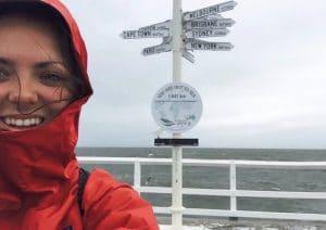Samantha Scott girl with a red hood on a bridge